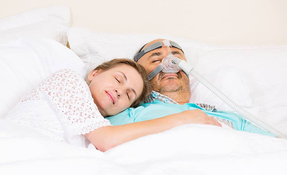 couple sleeping with cpap machine